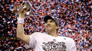New York Giants quarterback Eli Manning holds up the Vince Lombardi Trophy while celebrating his team's 21-17 win over the New England Patriots in Super Bowl XLVI, Feb. 5, 2012.