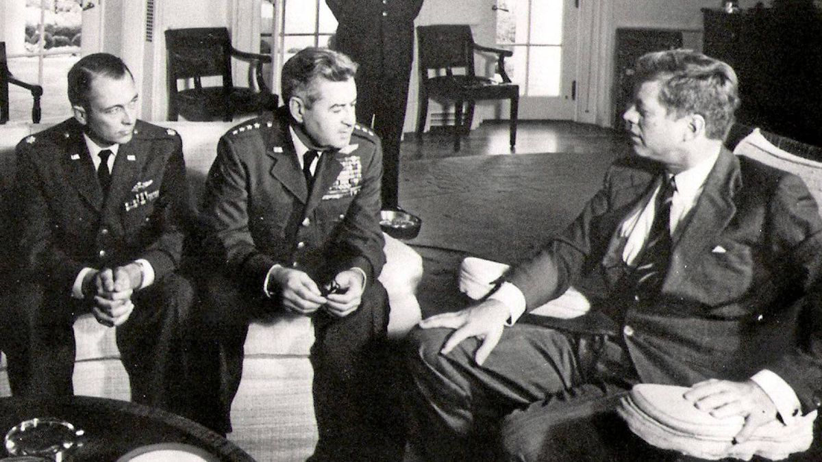 "In this 1962 file photo President John F. Kennedy meets with Air Force Maj. Richard ""Steve'' Heyser, left, and Air Force Chief of Staff, Gen. Curtis LeMay, center, at the White House in Washington to discuss U-2 spy plane flights over Cuba. The CIA in December 2008 censored copies of 1960s-era documents the AP requested under the Freedom of Information Act about former President Gerald Ford's work while still a congressman reviewing Kennedy's assassination, though the government had released the whole memo nearly two decades earlier."