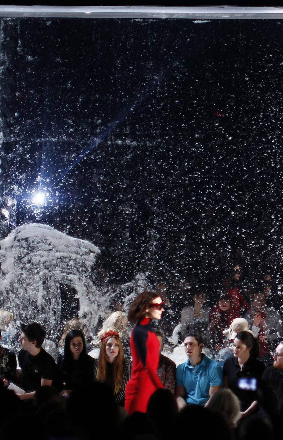 On Saturday, French brand Lacoste lined the runway with giant snow globe-like panels to set the stage for its haute sportif men's and women's show.