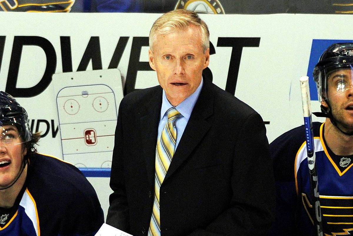 St. Louis Blues head coach Andy Murray talks to his players as they play the Vancouver Canucks in this file photo taken April 21, 2009.