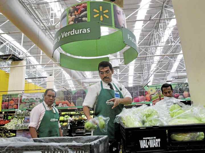 FILE -- Workers during their shift at a Wal-Mart store in Mexico City, March, 29, 2012. Recently, Wal-Mart's stock fell almost 5 percent on April 23, as investors reacted to a bribery scandal at the retailer's Mexican subsidiary and a report that an internal investigation was quashed at corporate headquarters in Arkansas.