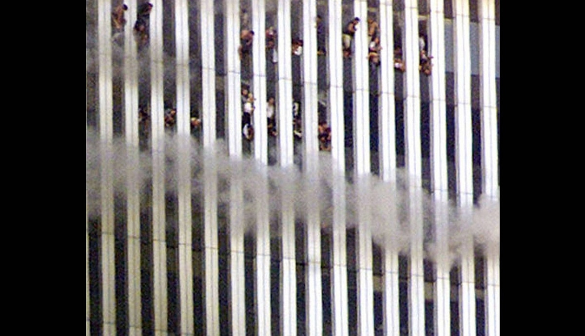 People look out of the burning north tower of the World Trade Center in New York City Sept. 11, 2001. Both towers were hit by planes crashing into the buildings. Shortly after this photo was taken this tower fell.