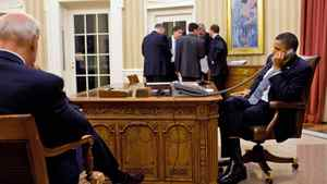 U.S. President Barack Obama talks on the phone with President Hosni Mubarak of Egypt in the Oval Office in Washington on Jan. 28, 2011.