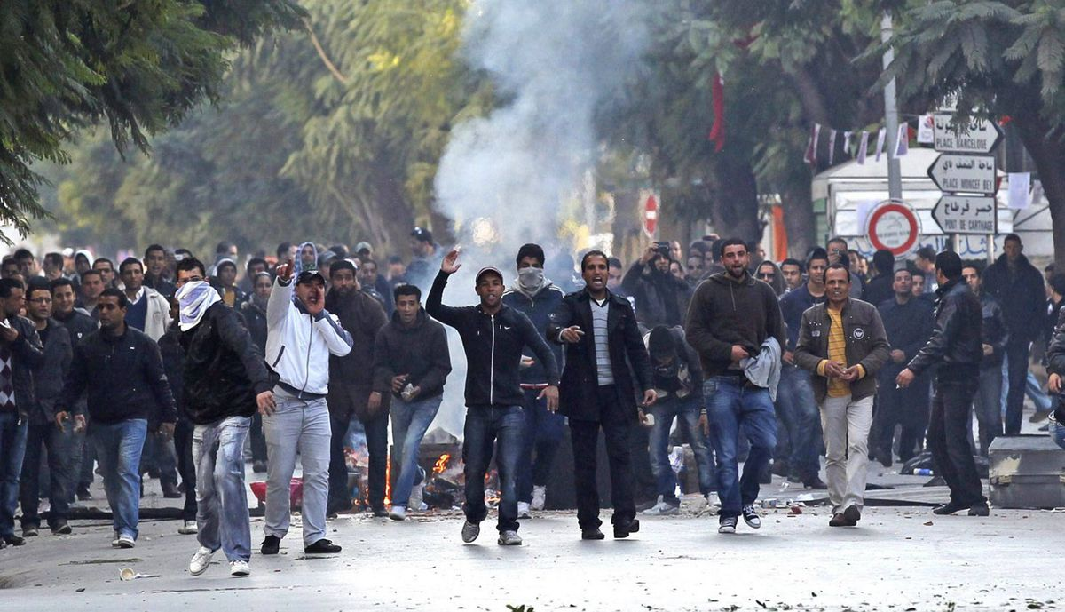 Demonstrators face police during clashes in Tunis, Jan. 14, 2011.