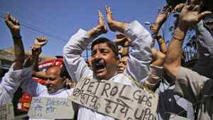 Indians in the state of Jammu shout slogans during a protest against the hike of petrol prices by nearly 11.5 per cent countrywide on Thursday, May 24, 2012.