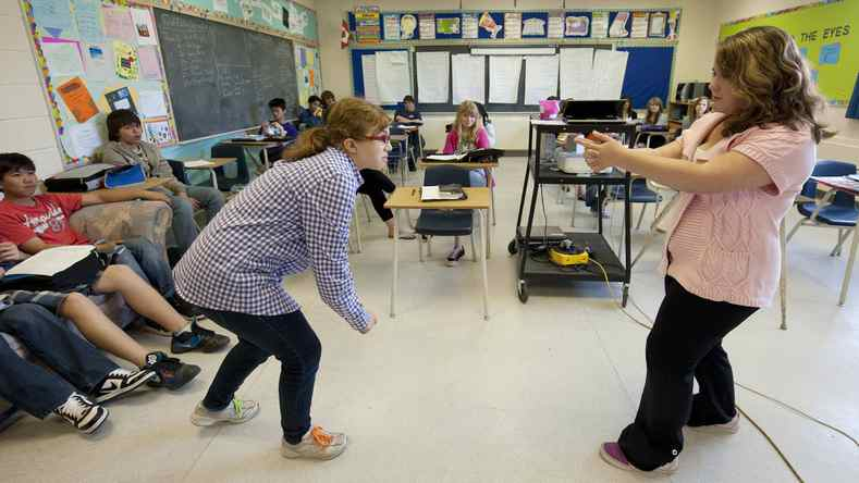 Students act out a skit in their Grade 8 language arts class at St. Joseph School in Calgary, June 13, 2011.