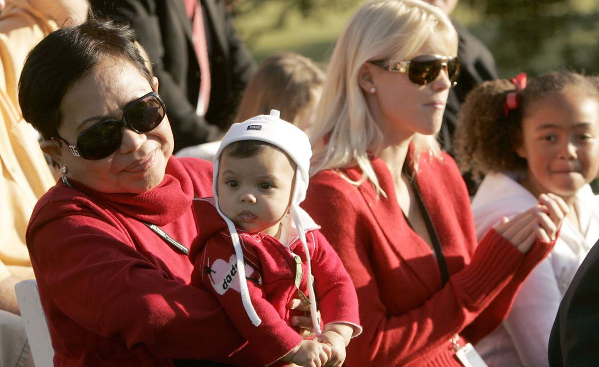 Tiger Woods's mother, Kultida, carries his daughter Sam Alexis Woods as wife Elin looks on after Woods won the Target World Challenge golf tournament in Thousand Oaks, California December 16, 2007.