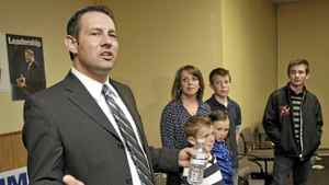 Newly-elected Jim Hillyer stands with his family as he thanks supporters on election night after winning the Lethbridge riding seat for the Conservative Party at his campaign headquarters on Monday, May 2, 2011 in Lethbridge, Alta.