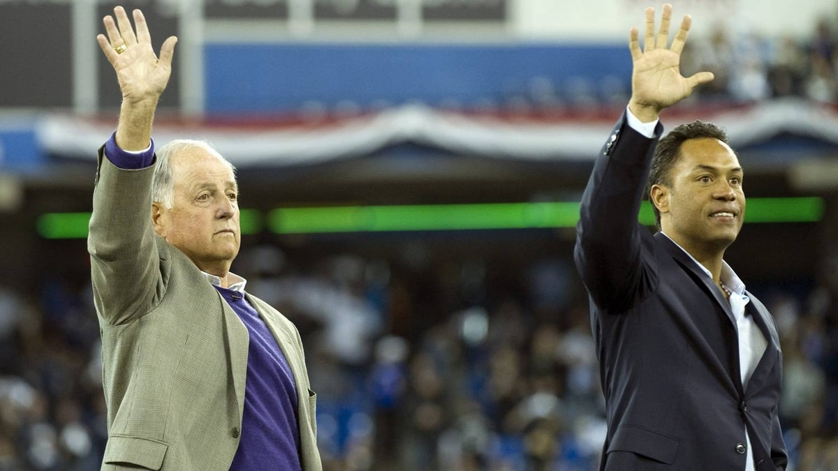 Baseball Hall of Fame inductees Pat Gillick and Roberto Alomar (right) wave to the crowd as they are introduced prior to Toronto Blue Jays, Minnesota Twins AL action in Toronto on Friday, April 1, 2011. THE CANADIAN PRESS/Nathan Denette