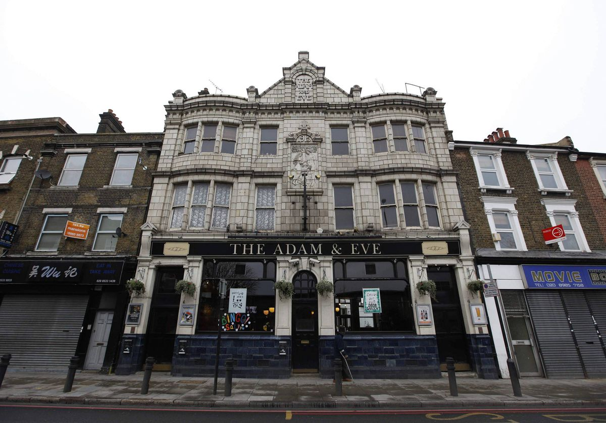 The Adam and Eve pub is seen in east London The 1915 frontage of the pub is unusually decorated with glazed tiles.