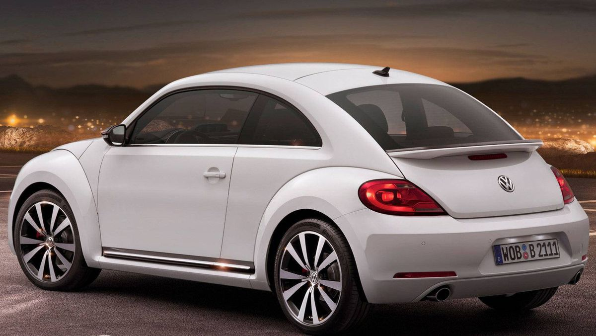 Seen from the rear, the 2012 Beetle bears a strong resemblance to its famous ancestor, yet is a far different car.