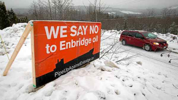 A sign showing opposition to the $5.5-billion Enbridge oil pipeline from Alberta to the northwest coast of British Columbia sits on a property in Kitimat, B.C., on Thursday Jan. 12, 2012.