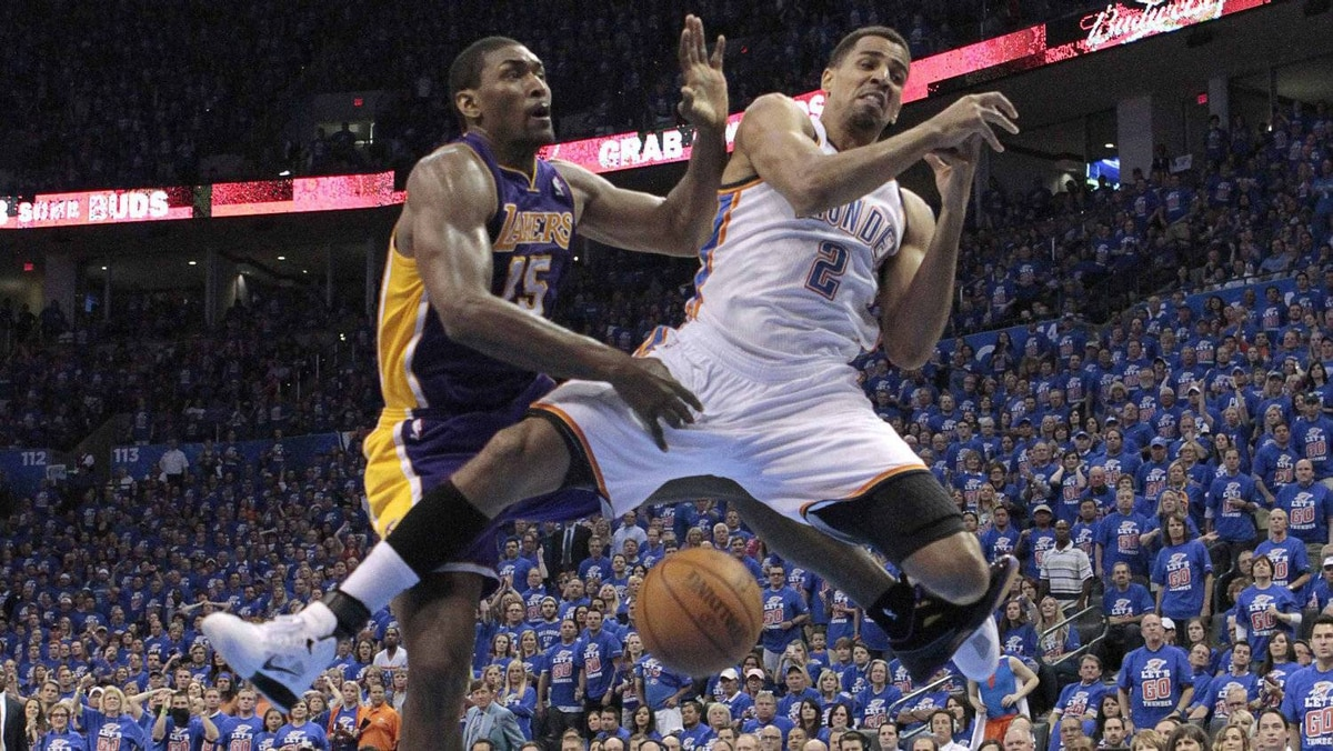 Los Angeles Lakers small forward Metta World Peace (15) is charged with a flagrant foul 1 on Oklahoma City Thunder shooting guard Thabo Sefolosha (2) in the first half during Game 5 of the NBA western conference semi-finals in Oklahoma City, Oklahoma, May 21, 2012. REUTERS/Steve Sisney