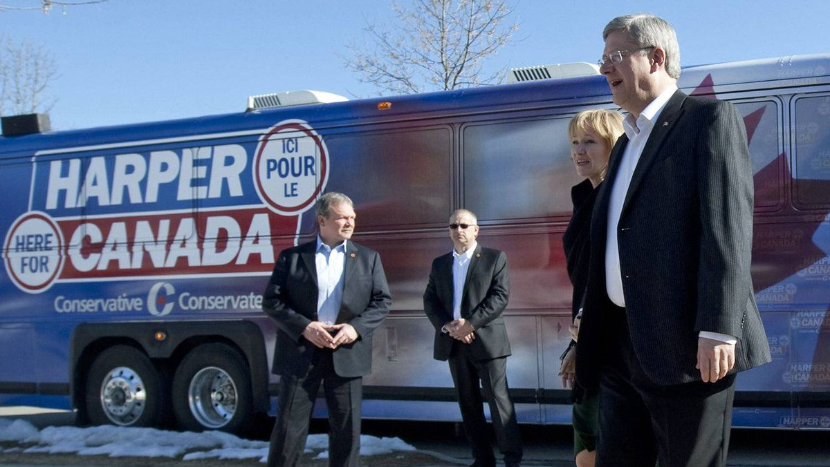 Prime Minister Stephen Harper and Laureen Harper step off the campaign bus as they stop in Brampton, Ont., on March 30, 2011.