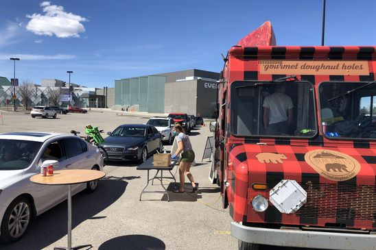 Drive-through dining goes upscale, from food trucks to $100 prix fixe menus