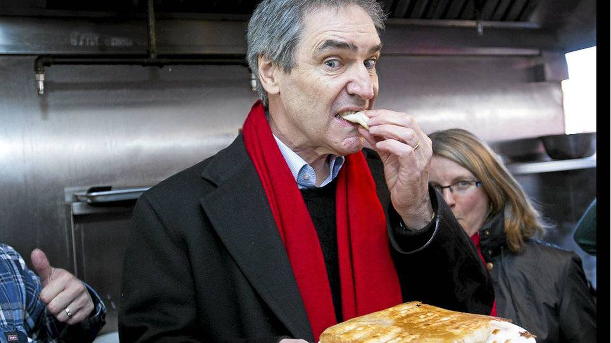 Liberal leader Michael Ignatieff noshes on Chinese dumplings in Toronto.