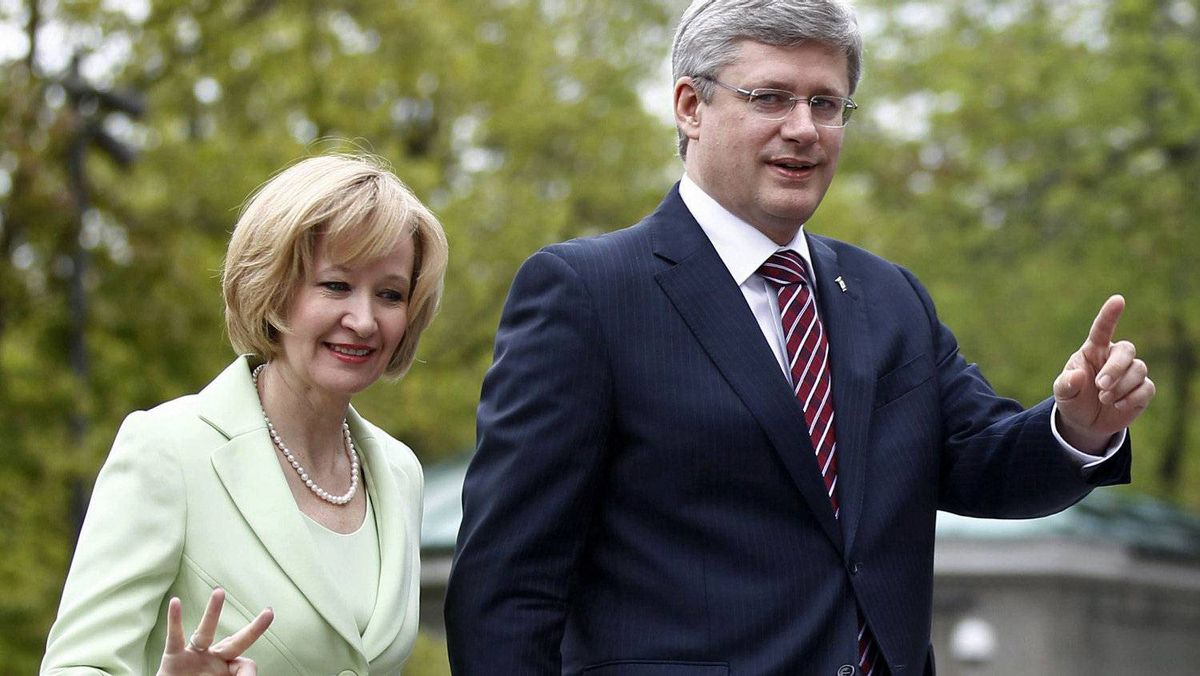 Prime Minister Stephen Harper arrives with his wife, Laureen, for a cabinet shuffle at Rideau Hall on May 18, 2011.