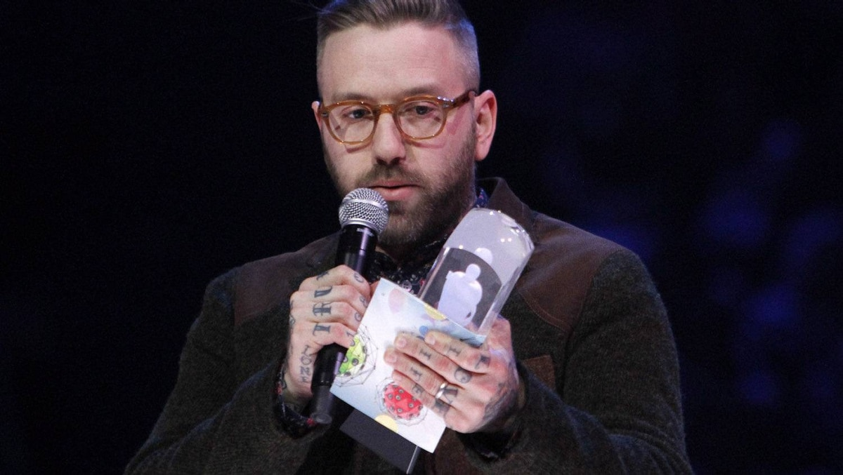 Dallas Green accepts the Songwriter of the Year during the Juno Awards ceremony in Ottawa, Sunday April 1, 2012.