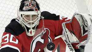 New Jersey Devils' goalie Martin Brodeur (30) makes a save on a shot from the Pittsburgh Penguins during the second period in an NHL hockey game at Prudential Center in Newark, N.J., Wednesday, Dec. 30, 2009. (AP Photo/Rich Schultz)