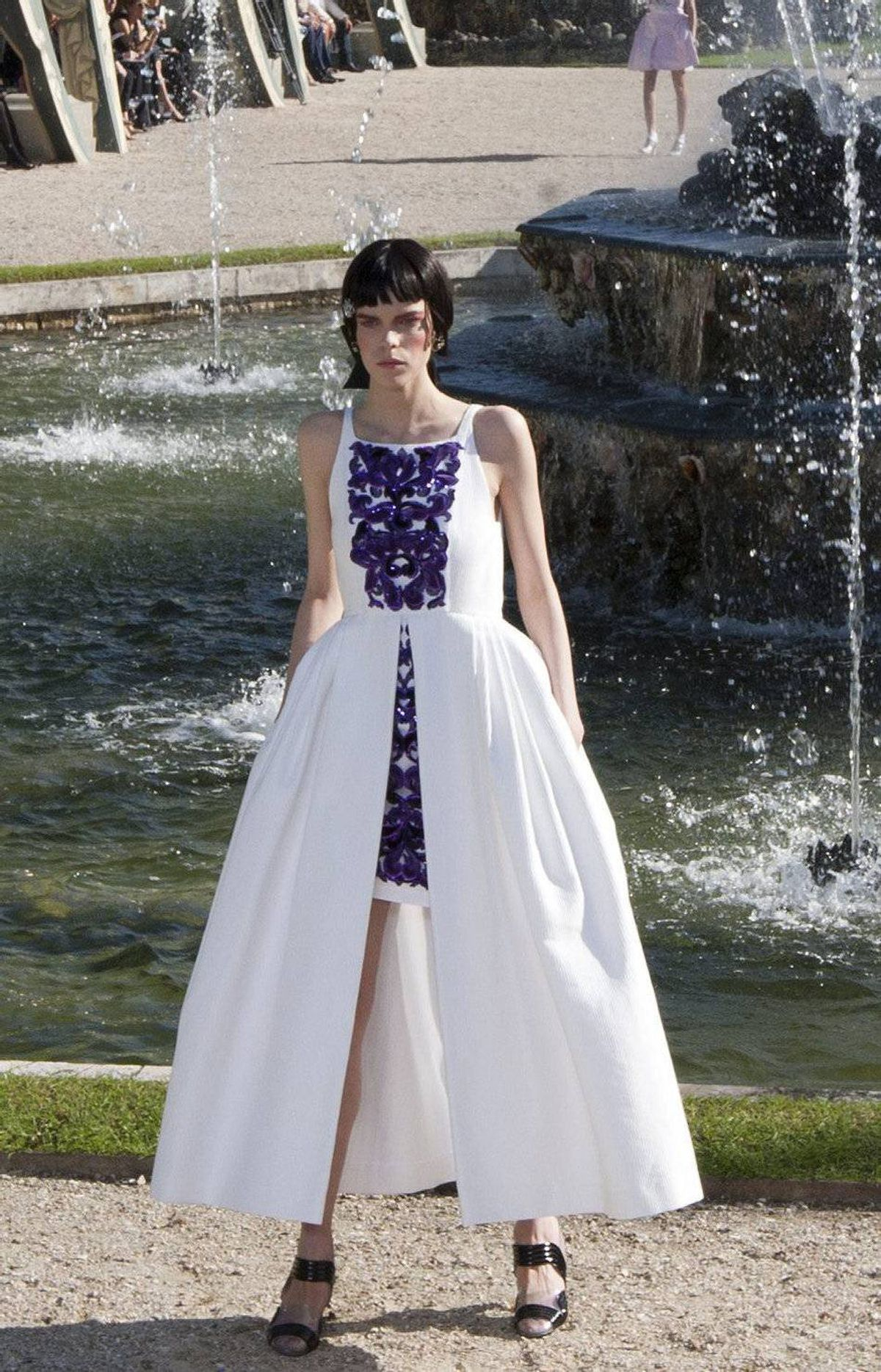 Guests donning enough Chanel to fill a museum show entered the palace grounds to an arrangement of cabanas placed around a grand fountain that spouted and burbled with gusto. Tilda Swinton, Vanessa Paradis and Vogue's André Leon Talley were some of the recognizable faces among international clients and editors.