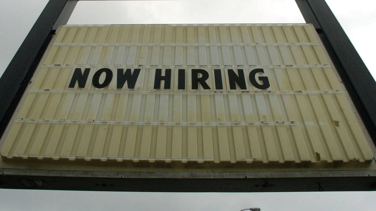 A 'now hiring' sign in Kitchener, Ont.