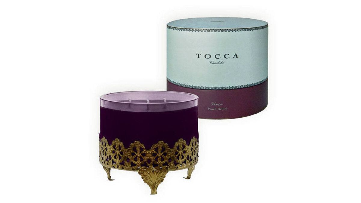 Transport her to another time and place with a finely scented candle evocative of exotic shores. Tocca's Venice candle in Peach Bellini, $58. tocca.com