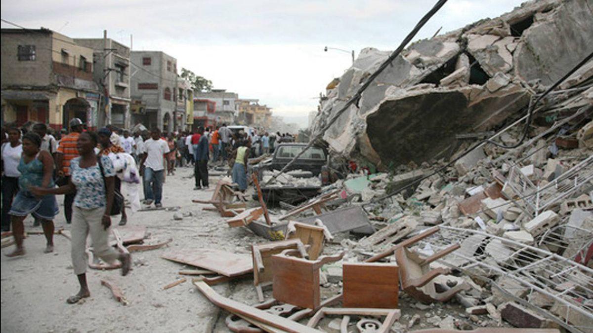 Haitians walk past destroyed buildings in Port-au-Prince. Daniel Morel/AFP/Getty Images