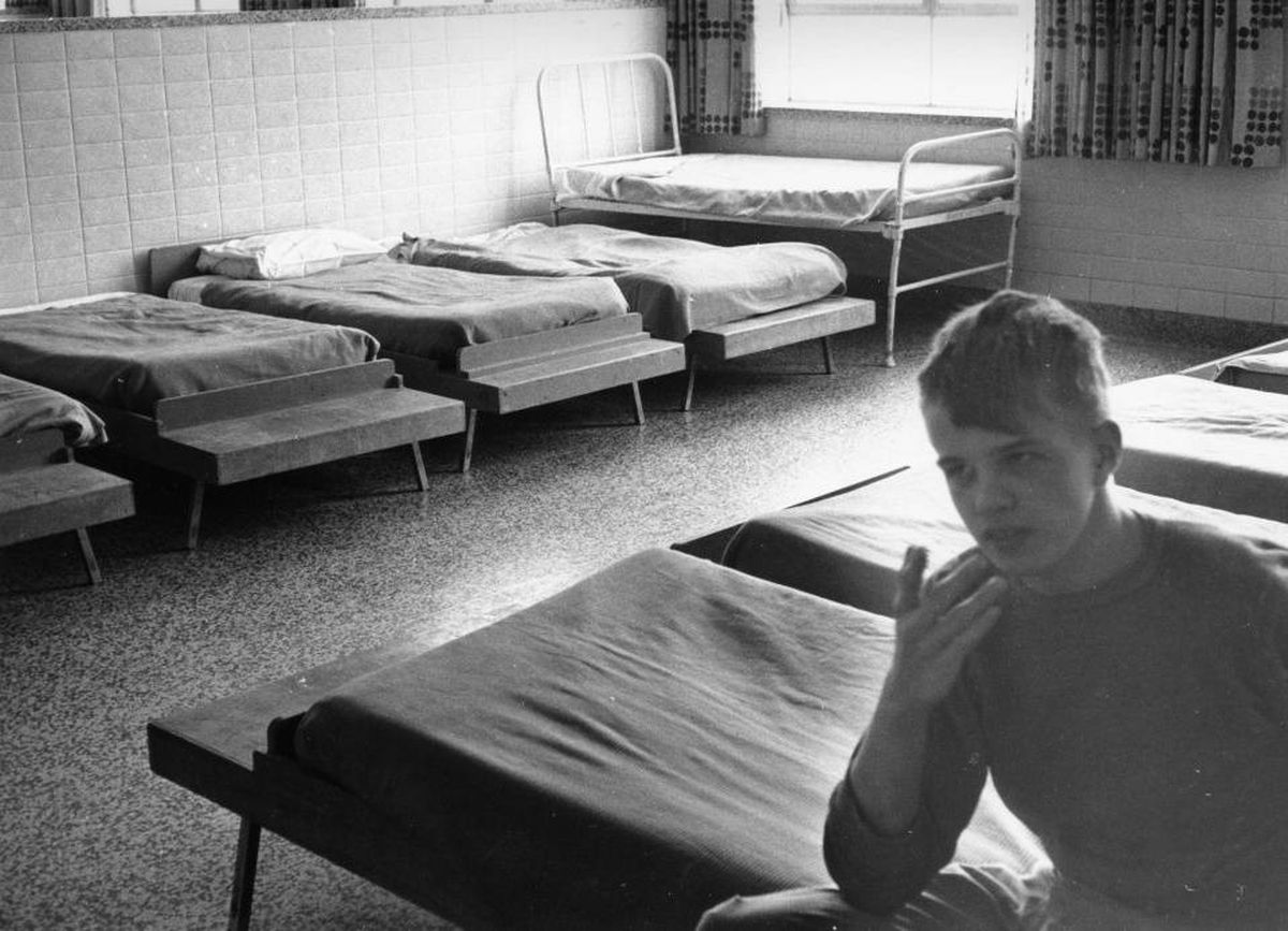 A young boy sits on a dormitory bed in 1971 the institution most recently known as the Huronia Regional Centre.