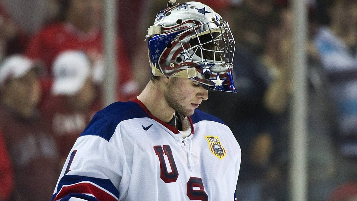 Team United States goalie Jack Campbell looks down after being defeated by Team Canada 4-1.