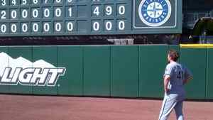 In this photo taken Saturday, April 21, 2012, and provided by the Chicago White Sox, White Sox starting pitcher Phil Humber views the scoreboard after pitching a perfect baseball game against the Seattle Mariners in Seattle. The right-hander recorded 27 outs on just 96 pitches as Mariner bats flailed trying to connect with his offerings.