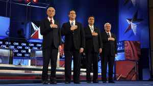 From the left: Ron Paul, Rick Santorum, Mitt Romney and Newt Gingrich sing the national anthem before the start of the Republican presidential debate in Mesa, Ariz., Feb. 22, 2012.