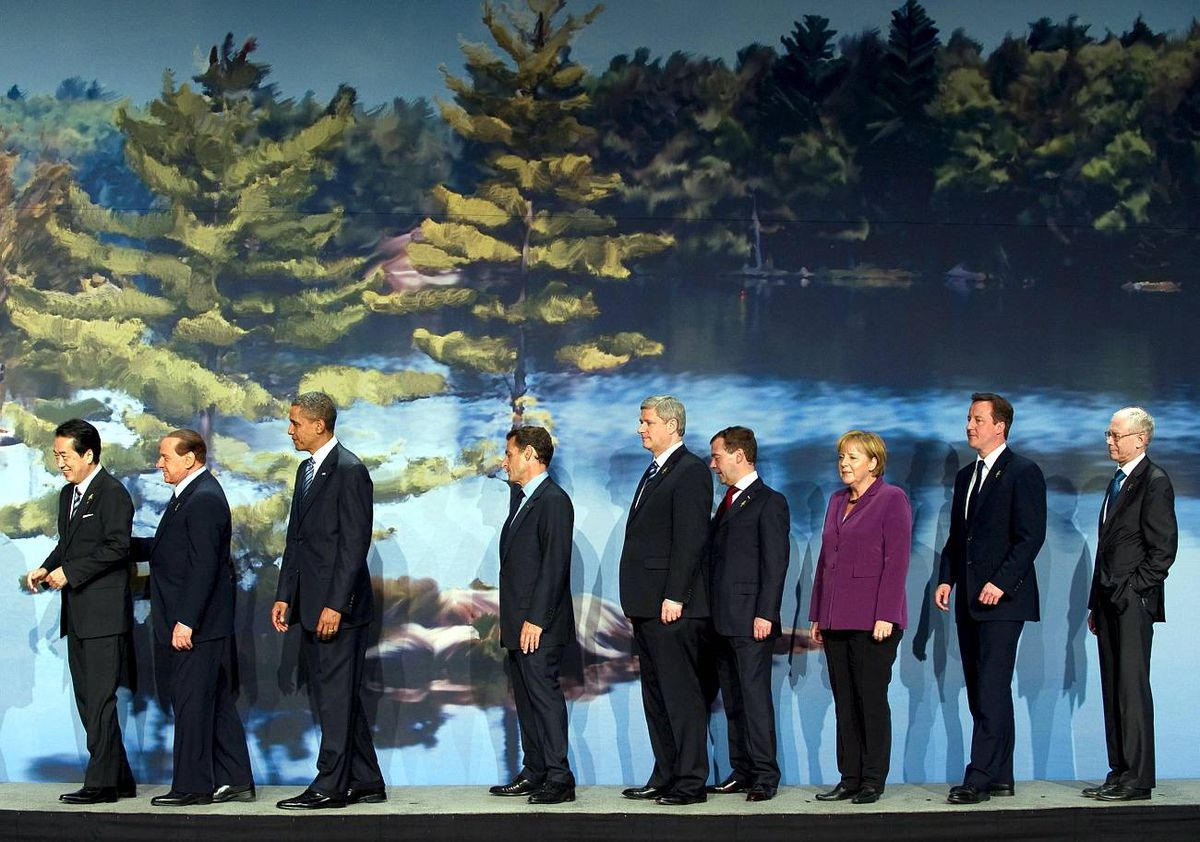 From left, Japan's Prime Minister Naoto Kan, Italy's Prime Minister Silvio Berlusconi, President Barack Obama, French President Nicolas Sarkozy, Canadian Prime Minister Stephen Harper, Russian President Dmitry Medvedev, German Chancellor Angela Merkel, British Prime Minister David Cameron and President of the European Council, Herman Van Rompuy leave following a 2010 G8 Summit photo ,with the My Summit 2010 Youth at the Deerhurst Resort in Huntsville.
