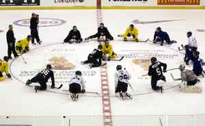 Canadian junior players stretch at centre ice.