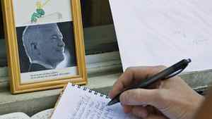 A woman signs a book of condolences outside late NDP leader Jack Layton's constituency office in Toronto on Aug. 23, 2011.