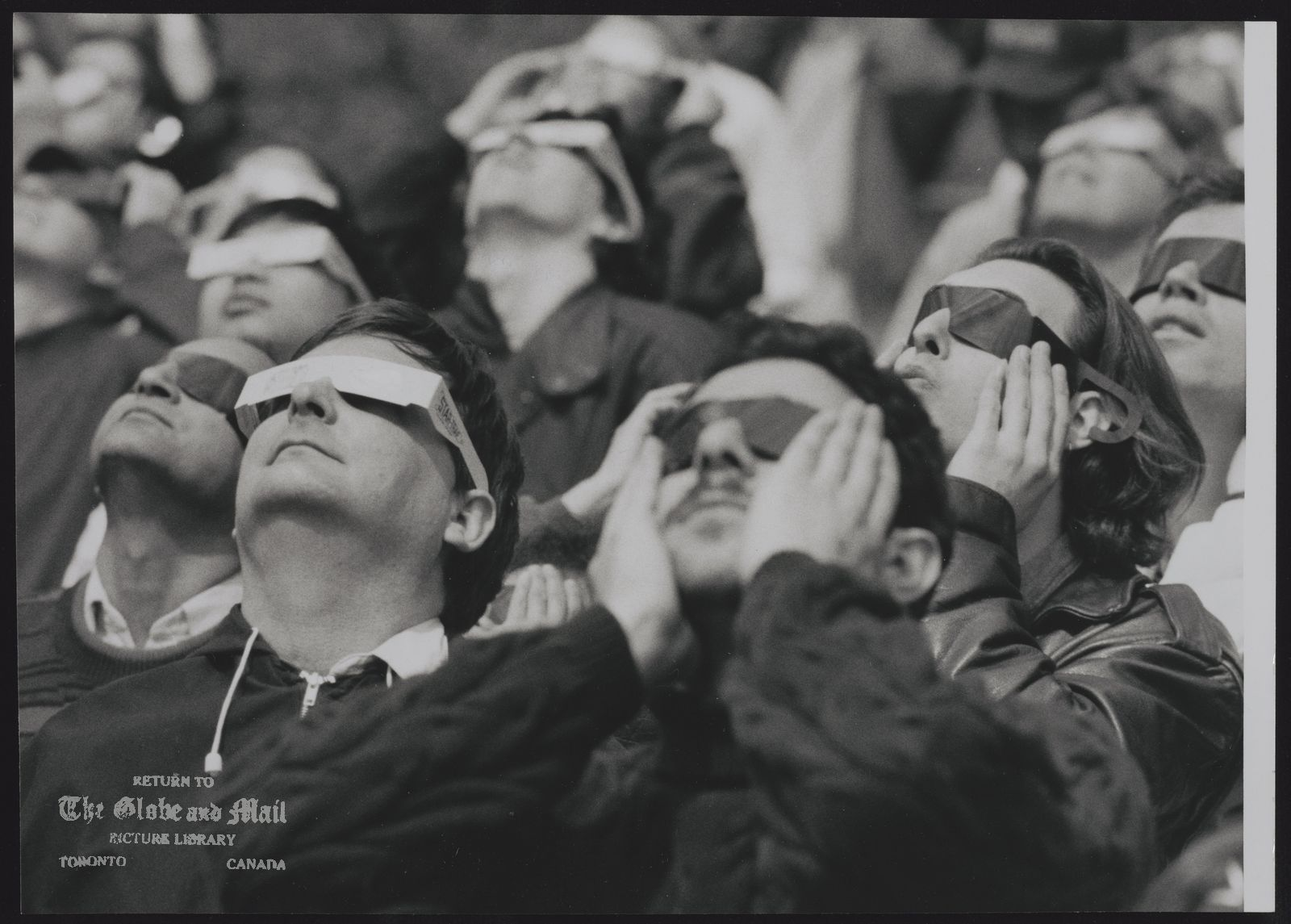 ECLIPSES TORONTO -- ANNULAR ECLIPSE OF THE SUN. VIEWERS AT THE ONTARIO SCIENCE CENTRE USED SPECIAL GLASSES TO VIEW THE EVENT.