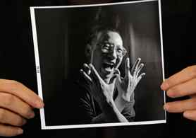 A photograph of Chinese dissident Liu Xiaobo is held by his wife Liu Xia during an interview in Beijing October 3, 2010. Imprisoned Chinese pro-democracy activist Liu Xiaobo won the Nobel Peace Prize on October 8, 2010, an announcement that Beijing has anticipated and bitterly criticised.