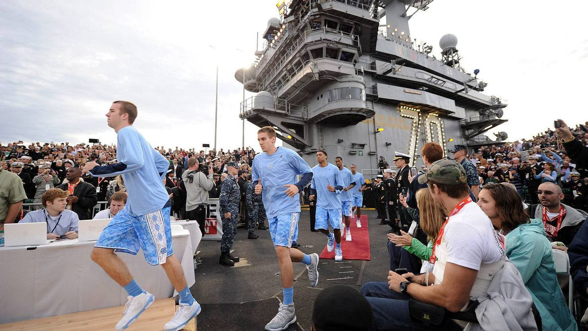 The North Carolina Tar Heels run out to the court before taking on the Michigan State Spartans during the NCAA men's college basketball Carrier Classic aboard the flight deck of the USS Carl Vinson on November 11, 2011 in San Diego, California. (Photo by Harry How/Getty Images)