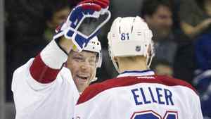 Montreal Canadiens Andrei Kostitsyn (L) congratulates Lars Eller after he scored against the Toronto Maple Leafs in the second period of their NHL hockey game in Toronto February 11, 2012. REUTERS/Fred Thornhill