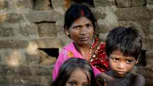 Poonam's mother, Rajkumari, and her children in their village of Jamsaut in Bihar, India.