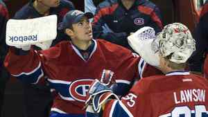 Montreal Canadiens' goaltender Carey Price, left, talks with fellow goaltender Nathan Lawson during second period pre-season NHL hockey action against the Dallas Stars in Montreal Tuesday, Sept. 20, 2011.