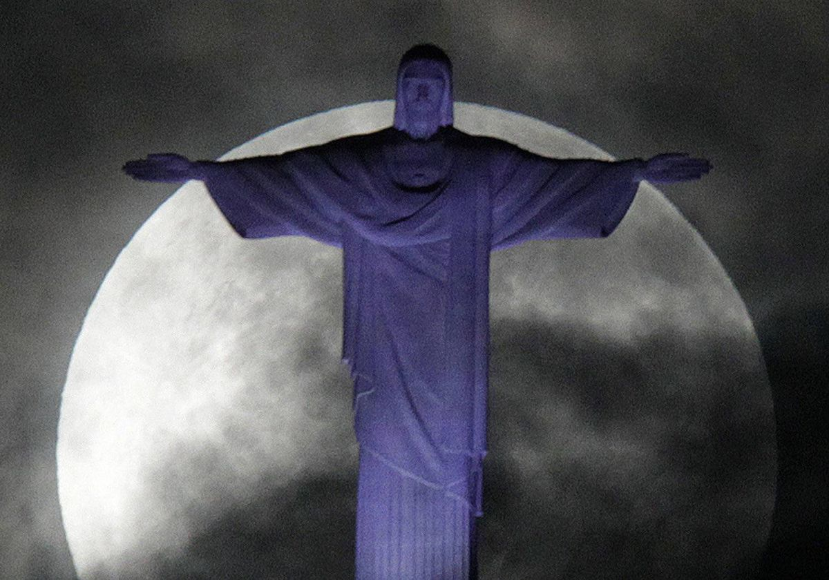 "The full ""super Moon,"" scientifically known as a ""perigee moon,"" is pictured over the Christ the Redeemer statue in Rio de Janeiro May 6, 2012."