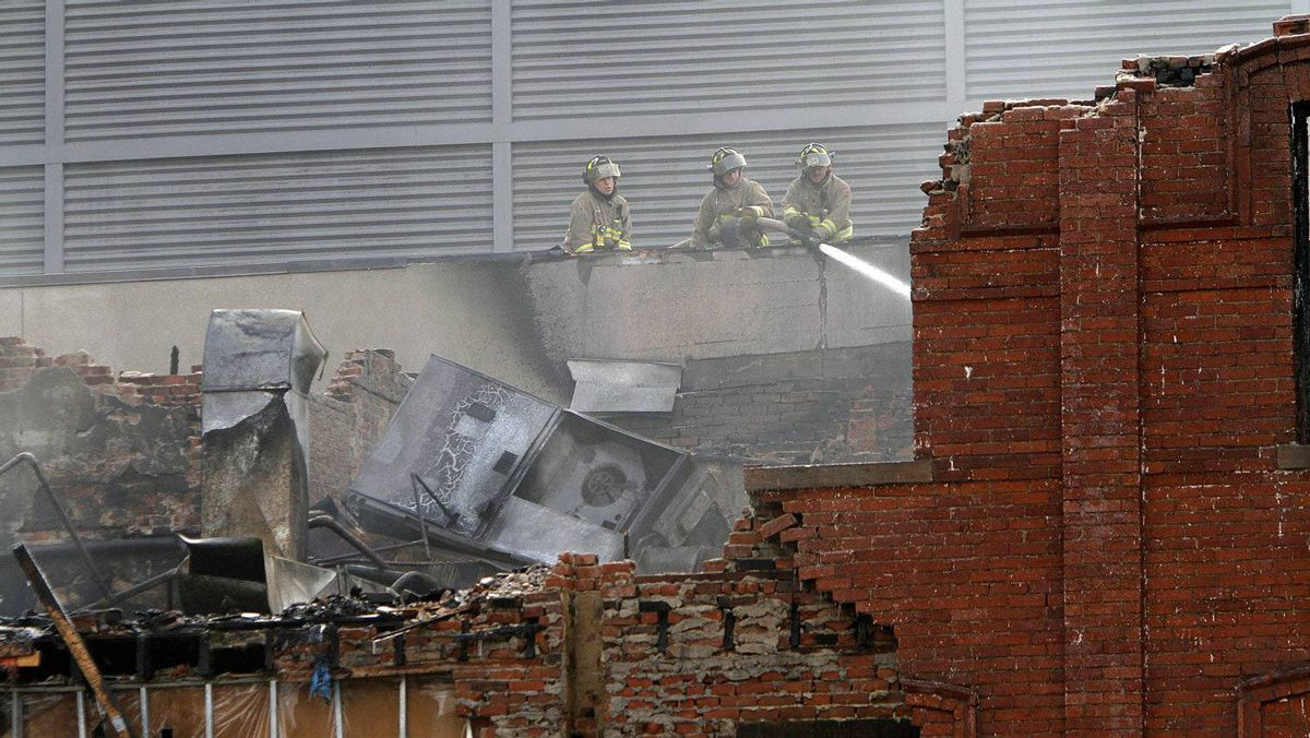 Firefighters work to extinguish a blaze that destroyed a heritage building at Yonge and Gould Streets on Jan. 3, 2011.