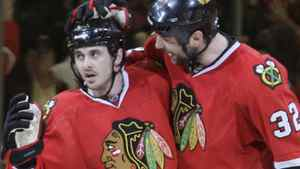 Chicago Blackhawks center Dave Bolland, left, celebrates his second-period goal with defenseman John Scott (32) in Game 4 of an NHL hockey Stanley Cup playoffs first-round series Tuesday, April 19, 2011, in Chicago. (AP Photo/Nam Y. Huh)