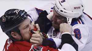 Ottawa Senators' Chris Neil (L) fights with New York Rangers' Brandon Prust during the first period of Game 6 of their NHL Eastern Conference quarter-final playoff hockey game in Ottawa, April 23, 2012. REUTERS/Chris Wattie