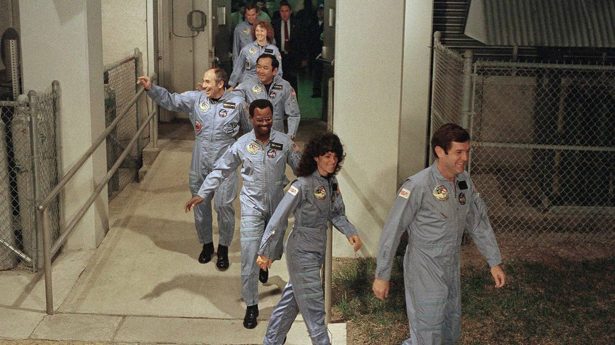 In this Jan. 27, 1986 file picture, the crew members of space shuttle Challenger flight 51-L, leave their quarters for the launch pad at Kennedy Space Center in Cape Canaveral, Fla. From foreground are commander Francis Scobee, Mission Spl. Judith Resnik, Mission Spl. Ronald McNair, Payload Spl. Gregory Jarvis, Mission Spl. Ellison Onizuka, teacher Christa McAuliffe and pilot Michael Smith.