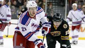 New York Rangers' Derek Stepan (21) brings the puck up in front of Boston Bruins' Tyler Seguin (19) during the first period of an NHL hockey game in Boston, Saturday, Jan. 21, 2012.