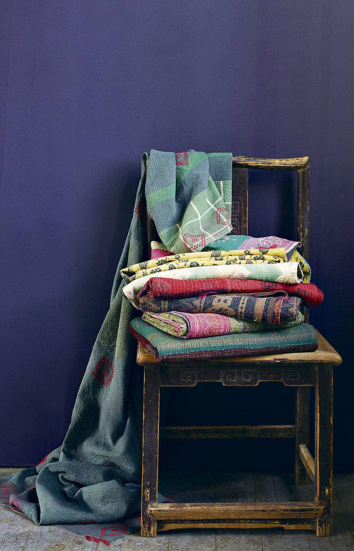 Have a basket of wraps and blankets on hand to help combat any chill. Hand-embroidered, these quilted throws from India are made by female artisans from recycled vintage saris. Kantha throws, $99 at West Elm.