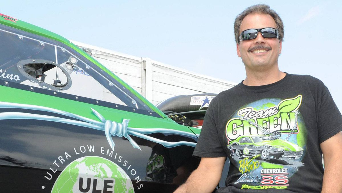 Eric Latino, founder of Global Emissions Systems, and his Green Team race car.