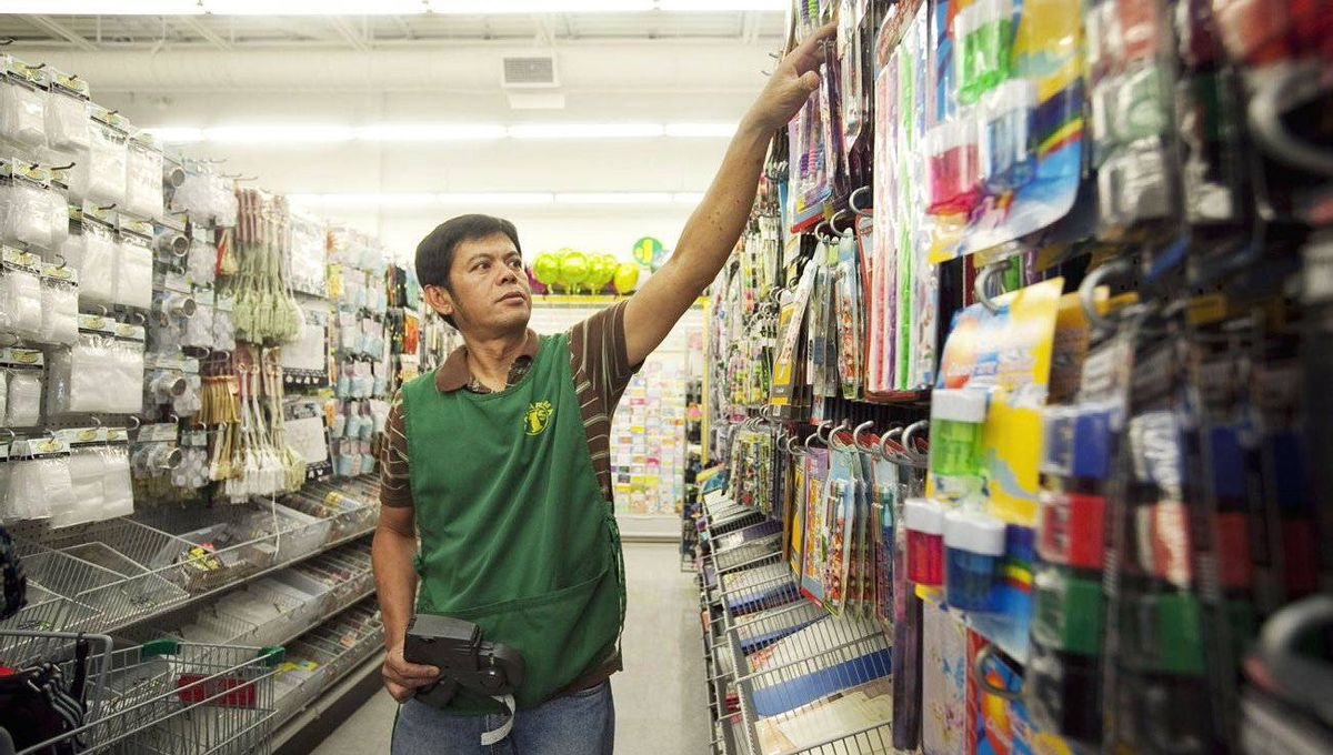 Clerk Nelson Suerte stocks shelves at a Dollarama store in Vaughan, Ont. The chain is opening roughly one new store a week.