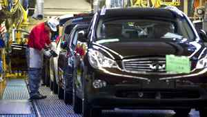 Nissan Motor Co.'s Infiniti brand vehicles bound for China, are given a final check after passing through the assembly line at the company's Tochigi plant in Tochigi Prefecture, Japan, on Thursday, Nov. 12, 2009.